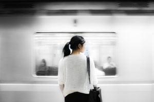 Woman watching train passing